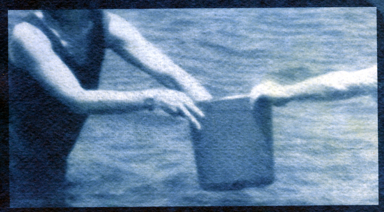 blue image of two people holding bucket, standing in water