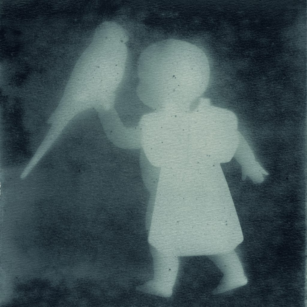 photogram silhouette of baby holding bird