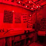 darkroom with hanging prints