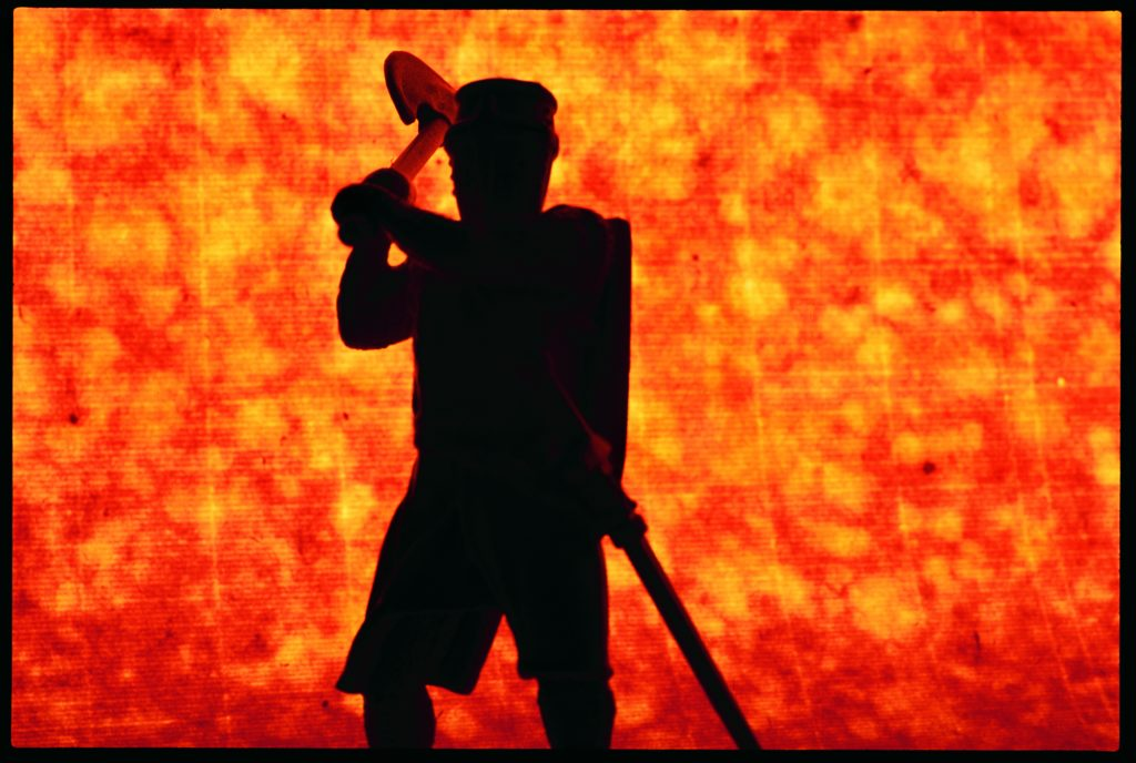 toy soldier with hachett with firey background
